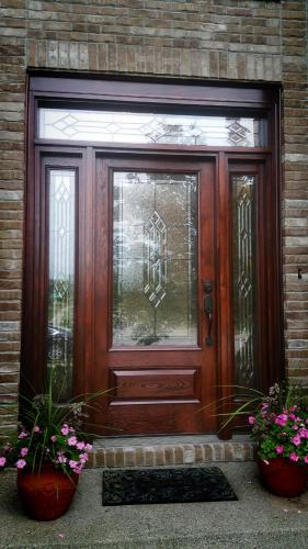 Therma-Tru Classic Craft stained with transom above. Oil rubbed bronze hardware, door, replacement door, door installation, Indianapolis, Carmel, Fishers, Indiana